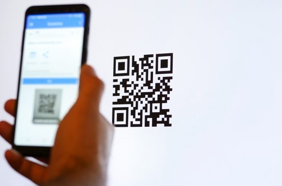 Scan QR code with smartphone on computer monitor.